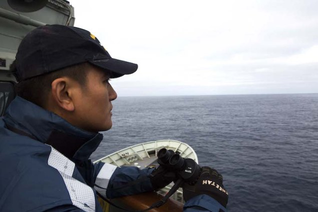 Able Seaman Januario Callos keeps watch on the starboard bridge-wing of HMAS Success during the search for the missing Malaysia Airlines Flight MH370. Photo (c) Commonwealth of Australia, Department of Defence