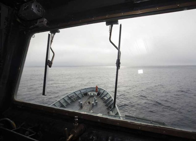 HMAS SUCCESS searches in the southern Indian Ocean for the missing Malaysia Airlines Flight MH370. A lookout can be seen at centre of the photo scanning the ocean's surface. Photo (c) Commonwealth of Australia, Department of Defence