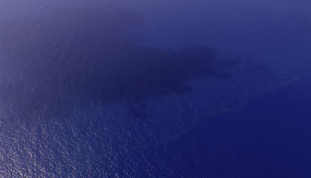 A view of oil slicks (pale line near the bottom right) spotted in an area of the South China Sea about 100 nautical miles (185 km) from Tok Bali Beach in Malaysia's Kelantan state March 9, 2014. REUTERS/Malaysian Maritime Enforcement Agency/Handout via Reuters