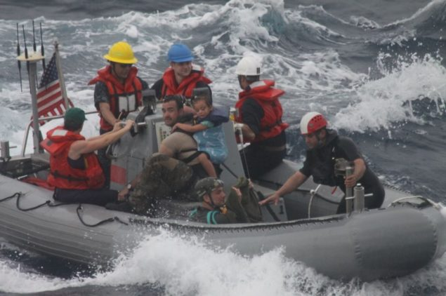 Sailors from Oliver Hazard Perry-class frigate USS Vandegrift (FFG 49) assist in the rescue of a family with a sick infant via the ship's small boat as part of a joint U.S. Navy, Coast Guard and California Air National Guard rescue effort. (U.S. Navy Photo/Released)