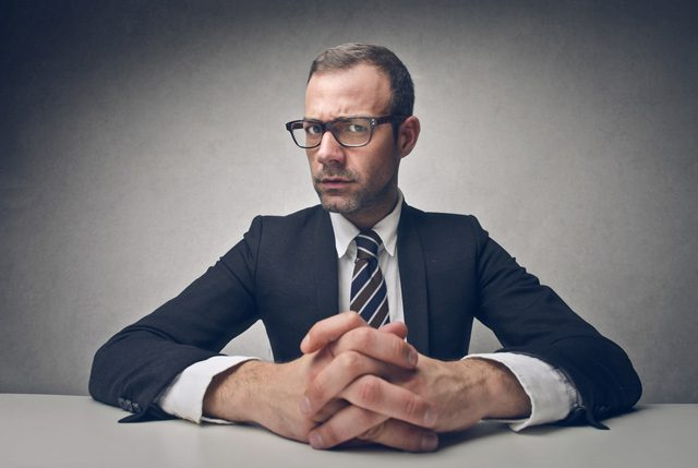 serious businessman interview interviewing question