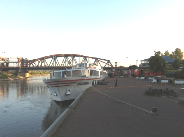 The river cruise Britannia moored on the IJssel River outside of Amsterdam.