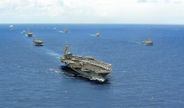 (July 25, 2014) The aircraft carrier USS Ronald Reagan (CVN 76) leads a close formation of 42 ships and submarines from 15 international partnership nations during Rim of the Pacific (RIMPAC) 2014. (U.S. Navy photo by Mass Communication Specialist 1st Class Dustin Kelling/Released)