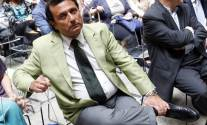 Captain of the capsized Costa Concordia Francesco Schettino looks at photographers as he attends a meeting in Rome July 10, 2014. The wreck of the Costa Concordia cruise liner is set to be refloated next week, to be towed away from the Italian island of Giglio where it ran aground and capsized two and a half years ago, the group organising the removal said last week. Schettino is on trial accused of manslaughter, causing a shipwreck and abandoning ship. Thirty-two people died in the catastrophe. REUTERS/Remo Casilli