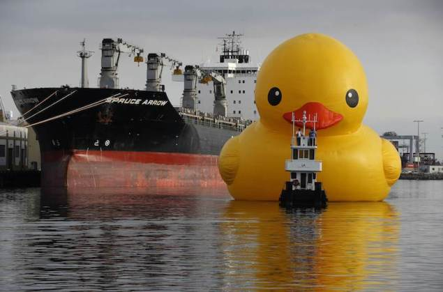 Giant inflatable rubber duck installation by Dutch artist Hofman floats through the Port of Los Angeles as part of the Tall Ships Festival, in San Pedro
