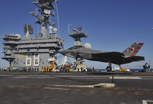 An F-35C Lightening II carrier variant Joint Strike Fighter conducts it's first arrested landing aboard the aircraft carrier USS Nimitz (CVN 68). Nimitz is underway conducting routine training exercises. (U.S. Navy photo by Mass Communication Specialist 3rd Class Kelly M. Agee/Released)