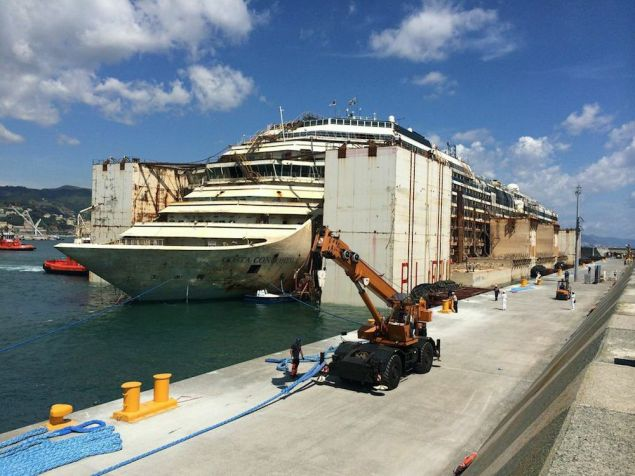 The Costa Concordia berthed at the port of Genoa, July 27, 2014. Photo courtesy Titan Salvage
