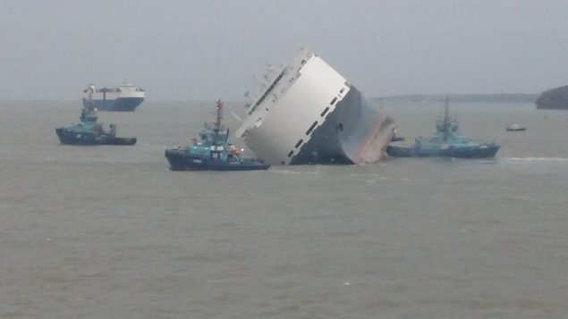 The Hoegh Osaka under tow Wednesday shortly after floating free from the Bramble Bank in the Solent.