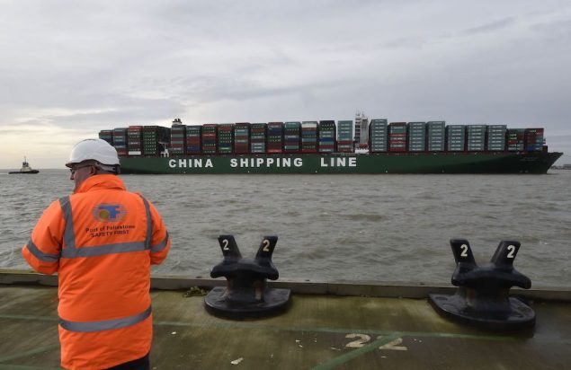 The former-largest container ship in world, CSCL Globe, docks during its maiden voyage, at the port of Felixstowe in south east England, January 7, 2015. REUTERS/Toby Melville