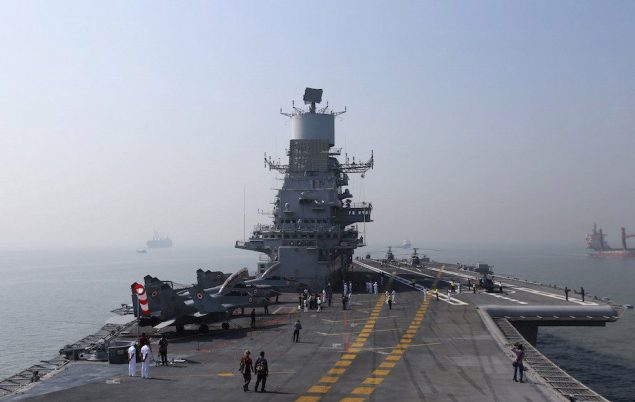 MiG-29K aircraft are parked on the deck of INS Vikramaditya, Indian Navy's aircraft carrier, anchored in the Arabian sea off the coast of Mumbai in this December 3, 2014 file photo. REUTERS/Shailesh Andrade/Files