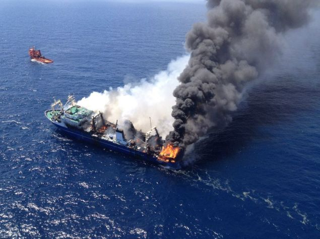 The Oleg Naydenov seen on fire after being towed out to see off the Canary Islands. Photo: Salvamento Maritimo