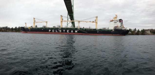 The MV Juno, a 621-foot bulk carrier, sits aground under the Thousand Islands Bridge, April 20, 2015. U.S. Coast Guard Photo