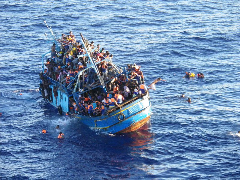 File photo shows a migrant boat in distress in the Mediterranean Sea. Photo: TORM A/S