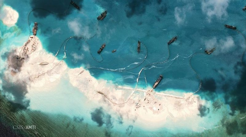 Dredgers deposit sand on the northern rim of the Mischief Reef, located 216 km (135 miles) west of the Philippine island of Palawan. REUTERS/CSIS's Asia Maritime Transparency Initiative/Digital Globe/Handout