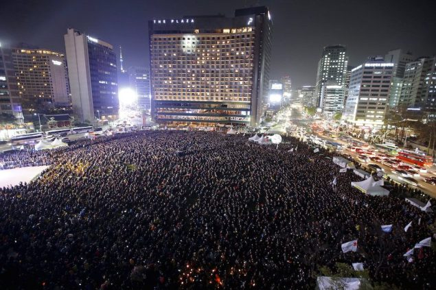 Thousands of mourners attend a rally to commemorate the first anniversary of the Sewol ferry disaster that killed more than 300 passengers, in central Seoul April 16, 2015. REUTERS/Kim Hong-Ji