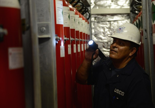 Tim Wilcox, a port state control officer at Coast Guard Sector Honolulu Prevention, inspects carbon dioxide tanks aboard the 600-foot Panamanian-flagged bulk freight ship Teizan, at Kalaeloa Barbers Point Harbor, May 19, 2015. Coast Guard crew members conduct inspections to ensure a vessel has a suitable structure, correct documentation, proper working equipment and lifesaving equipment, and adequate accommodations. (U.S. Coast Guard photo by Petty Officer 2nd Class Tara Molle)