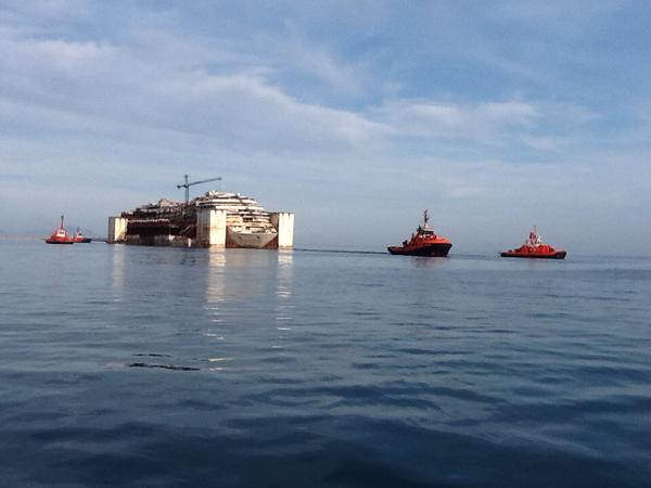 The Costa Concordia under tow off Genoa, Italy, May 11, 2015. Photo: Port of Genova