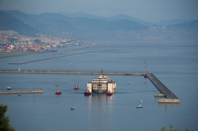 Costa Concordia is maneauvered away from the breakwater at Prà Voltri on Monday, May 11, 2015.