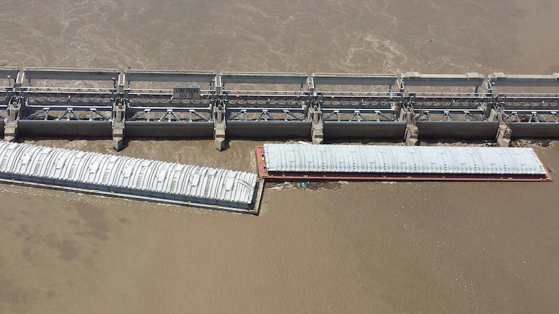 On June 14, 2014, two barges broke free from a tug and drifted into the protection cells of the Starved Rock Lock and Damn on the Illinois River in Utica. Photo: U.S. Coast Guard