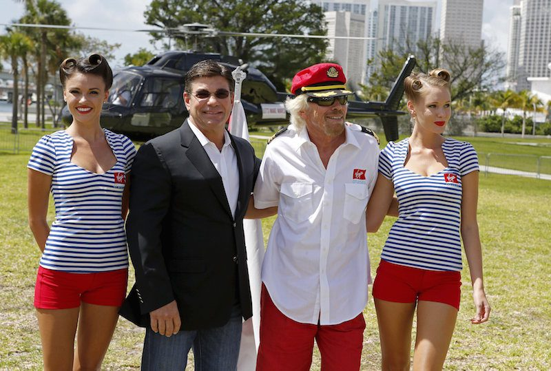 File Photo: Sir Richard Branson with Virgin Voyages' President and CEO Tom McAlpin as he arrives by helicopter for a news conference at the Perez Art Museum in Miami, Florida June 23, 2015. Branson's London-based Virgin Group is launching a cruise line with two, custom-designed ships the company announced on Tuesday. The Virgin Group, which already has an airline and space tourism businesses, is partnering with private investment firm Bain Capital for the cruise line. REUTERS/Joe Skipper