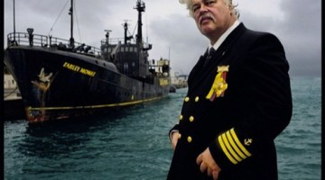 Captain Paul Watson next to the RV Farley Mowat