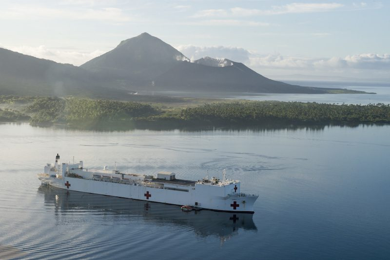 Mercy sits at anchorage in Simpson Harbor in Rabaul during Pacific Partnership 2015