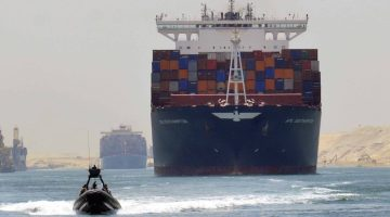 A cargo ship is seen crossing through the New Suez Canal, Ismailia, Egypt, July 25, 2015. The first cargo ships passed through Egypt's New Suez Canal on Saturday in a test-run before it opens next month, state media reported, 11 months after the army began constructing the $8 billion canal alongside the existing 145-year-old SuezCanal. Mohab Mameesh, chairman of the Suez Canal Authority overseer of the project, told state television that this test-run had been a success and that more would follow. REUTERS/Stringer      TPX IMAGES OF THE DAY