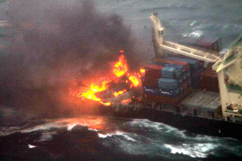This photo of the MV Kamala shows the fire in the cargo area amidships.