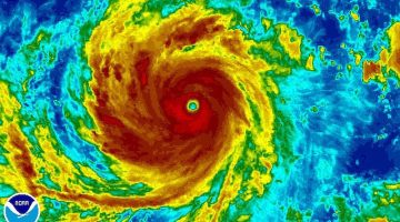 Super Typhoon Soudelor is seen in an enhanced infrared NOAA satellite image taken in the Western Pacific Ocean at 08:32 ET (12:32 GMT) August 4, 2015. REUTERS/NOAA/Handout
