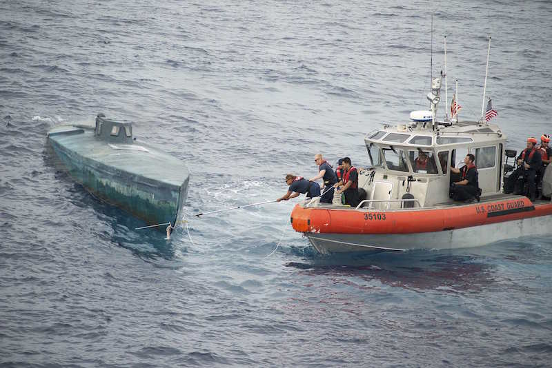 Crew from the U.S. Coast Guard Cutter Stratton stop a Self-Propelled Semi Submersible (SPSS) off the coast of Central America in this U.S. Coast Guard picture taken July 18, 2015 and released August 5, 2015. REUTERS/U.S. Coast Guard/Petty Officer 2nd Class LaNola Stone