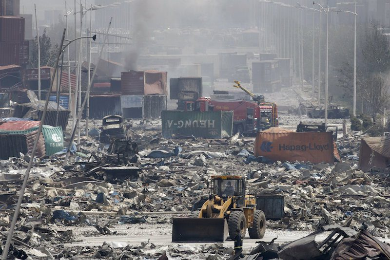 A bulldozer works near the site of the explosions at the Binhai new district, Tianjin, August 13, 2015. REUTERS/Jason Lee