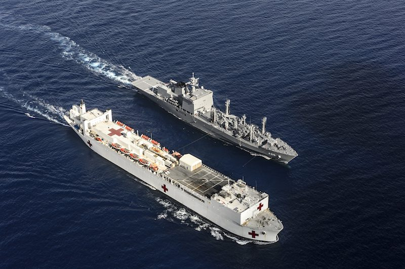 WESTERN PACIFIC (Aug. 13, 2015) The Japanese fleet oiler JS Mashu (AOE 425) takes part in a replenishment at sea with the hospital ship USNS Mercy (T-AH 19) during Pacific Partnership 2015. Pacific Partnership is in its tenth iteration and is the largest annual multilateral humanitarian assistance and disaster relief preparedness mission conducted in the Indo-Asia-Pacific region. While training for crisis conditions, Pacific Partnership missions to date have provided real world medical care to approximately 270,000 patients and veterinary services to more than 38,000 animals. Additionally, the mission has provided critical infrastructure development to host nations through more than 180 engineering projects. (U.S. Navy photo by Mass Communication Specialist 2nd Class Mark El-Rayes/Released)