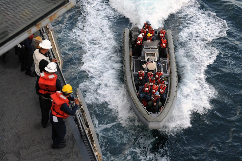 150402-N-RC734-027 PACIFIC OCEAN (April 2, 2015) Sailors standby to receive a rigid-hull inflatable Boat as it transits alongside the amphibious transport dock ship USS San Diego (LPD 22). San Diego is conducting drills and exercises off of the coast of California. (U.S. Navy photo by Mass Communication Specialist 1st Class Joseph M. Buliavac/Released)