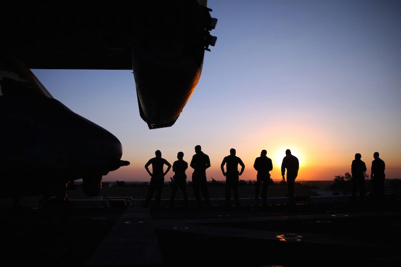 150621-M-QZ288-113 SUEZ CANAL, Egypt (June 21, 2015) Marines with the 24th Marine Expeditionary Unit (24th MEU) watch the sunset as the amphibious assault ship USS Iwo Jima (LHD 7) transits through the Suez Canal. The 24th MEU and Iwo Jima Amphibious Ready Group (ARG) transit the canal, a 120-mile long waterway connecting the Red Sea to the Mediterranean, and entered the U.S. 6th Fleet area of operations. The 24th MEU is deployed on the ships of the Iwo Jima ARG in support of U.S. national security interests in the U.S. 6th Fleet area of operations. (U.S. Marine Corps photo by Lance Cpl. Austin A. Lewis/Released)