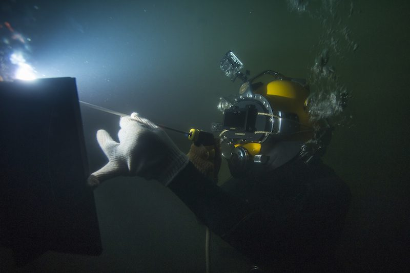 150714-N-WB378-199 MIAMI (July 14, 2015) Steel Worker 1st Class Jesse Hamblin, assigned to Underwater Construction Team (UCT) 2, makes a vertical fillet weld on a half inch steel plate. Members of UCT-2 are attending a 10-day underwater welding course provided by Hydroweld, in order to develop techniques required to weld in accordance with the American Welding Society, wet welding standards. (U.S. Navy photo by Mass Communication Specialist 1st Class Blake Midnight/Released)