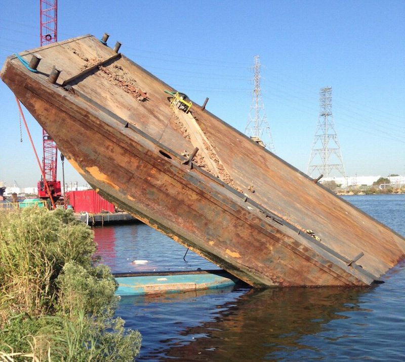 The Coast Guard closed a section of the Upper Houston Ship Channel Monday, Oct. 19, 2015, after the tug Annie Moon and attached barge sank across from the Kinder Morgan terminals in Galena Park. The barge was carrying 60 to 80 foot long sheets of two-foot wide metal.