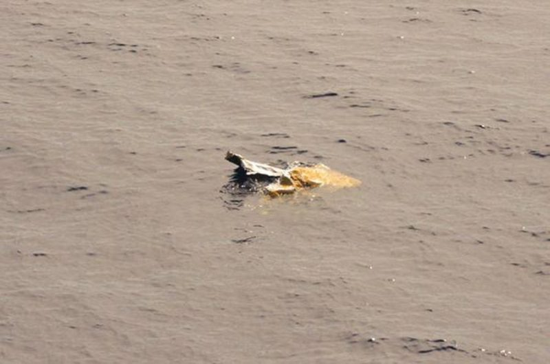 Debris is seen in the water from the El Faro search area in this handout photo provided by the US Coast Guard, October 6, 2015. REUTERS/US Coast Guard