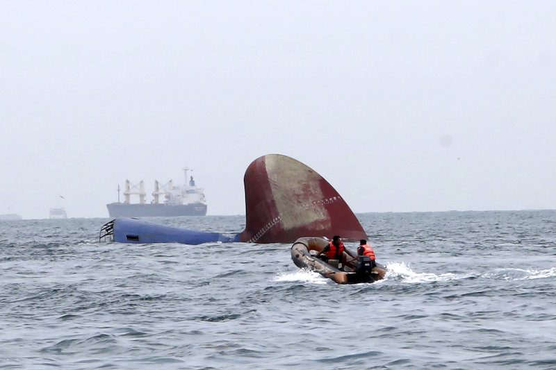 An Indonesia rescue team approaches the sunken Antigua and Barbuda flagged freighter MV Thorco Cloud which sank after colliding with a tanker the night before, in the Singapore Strait off the Indonesian island of Batam December 17, 2015 in this photo taken by Antara Foto. REUTERS/M N Kanwa/Antara Foto
