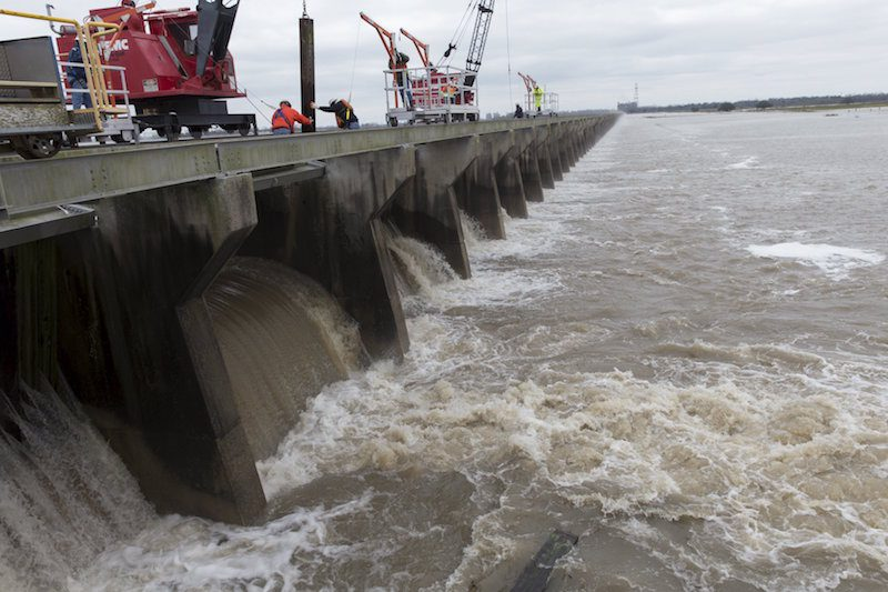 Workers open the Bonnet Carre Spillway in Norco, Louisiana, January 10, 2016. The United states Army Corps of Engineers decided to open the spillway to relieve high water levels in the Mississippi River. REUTERS/Lee Celano