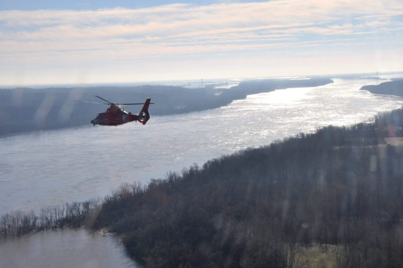 A Coast Guard MH-65 Dolphin helicopter crew surveys the region surrounding Cape Girardeau, Mo., as part a joint response to the Midwest Flooding, Jan. 3, 2016. Coast Guard aircrews were brought to Cape Girardeau to be used as search and rescue platforms and monitor high water and flooding in the region. (Photo courtesy of U.S. Coast Guard Aircrews)