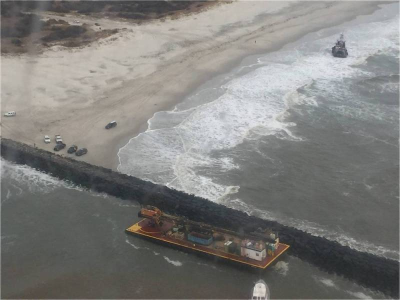 The 77-foot tugboat Miss Katie and the 135-foot barge it was towing ran aground near the Absecon Inlet Saturday, Feb. 20, 2016. The tugboat lost power and its towlines fouled in the propellers causing the two vessels to drift and ground.
