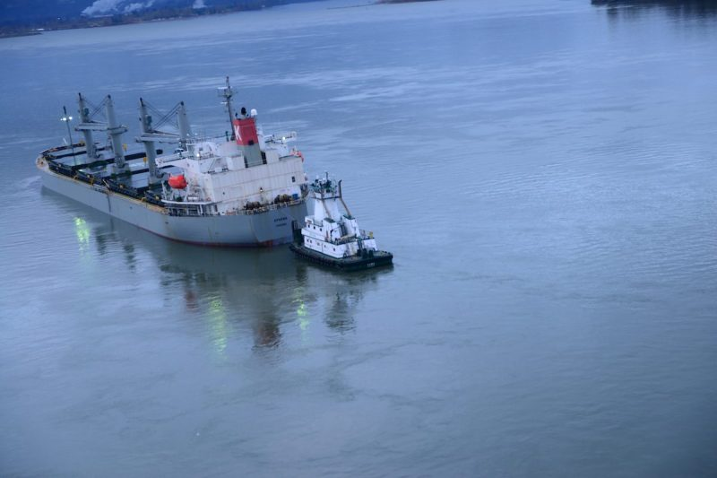 The MV Sparna, a 623-foot Panamanian-flagged bulk carrier, lists to its port side after taking on water in void spaces after reportedly running aground while transiting the Columbia River near Cathlamet, Wash., March 21, 2016. The vessel is safely anchored and the Coast Guard is monitoring the situation until repairs can be made. (U.S. Coast Guard photo by Petty Officer 1st Class Levi Read)