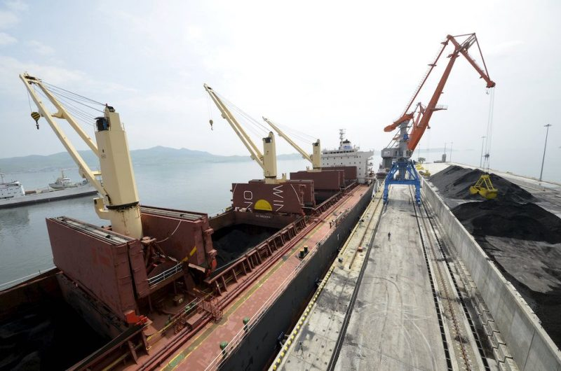 A cargo ship is loaded with coal during the opening ceremony of a new dock at the North Korean port of Rajin in this July 18, 2014 file photo. REUTERS/Yuri Maltsev/Files