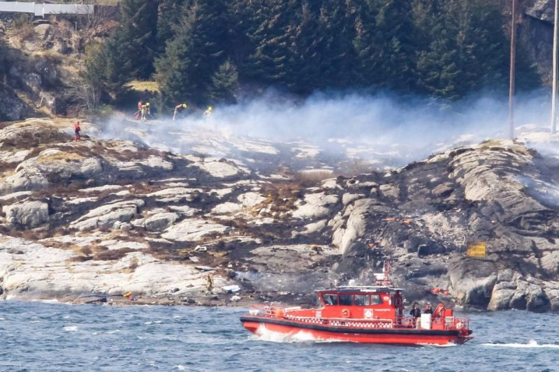 Rescuers work at a site where a helicopter has crashed, west of the Norwegian city of Bergen April 29, 2016. NTB Scanpix/Bergens Tidende/ REUTERS