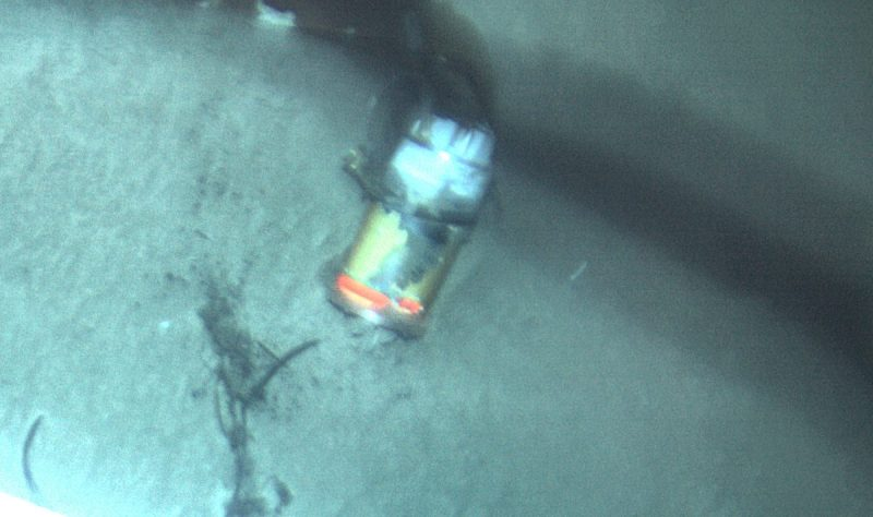 El Faro's VDR seen in the sand at a depth of 15,000 feet off the Bahamas. Photo credit: NTSB