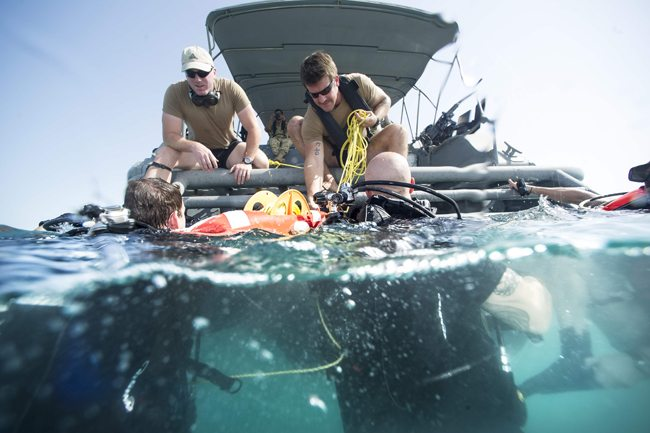 141109-N-CG436-007 ARABIAN GULF (Nov. 9, 2014) Explosive ordnance disposal technicians from Commander, Task Group 56.1 prepare to exit the water after completing a scuba dive off the coast of Bahrain during the International Mine Countermeasures Exercise (IMCMEX). With a quarter of the world's navies participating, including 6,500 Sailors from every region, IMCMEX is the largest international naval exercise promoting maritime security and the free-flow of trade through mine countermeasure operations, maritime security operations and maritime infrastructure protection in the U.S. 5th Fleet area of responsibility and throughout the world. (U.S. Navy photo by Mass Communication Specialist 2nd Class Michael Scichilone/Released)