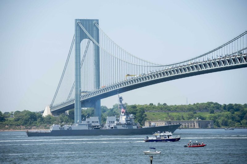 160525-N-KG407-296 NEW YORK (May 5, 2016) — Arleigh Burke-class guided missile destroyer USS Bainbridge (DDG 96) passes under the Verrazano Bridge during a parade of ships in the New York Harbor river to mark the start of 2016 Fleet Week New York. The event Fleet Week New York, now in its 28th year, is the city's time-honored celebration of the sea services. It is an unparalleled opportunity for the citizens of New York and the surrounding tri-state area to meet Sailors, Marines and Coast Guardsmen, as well as witness firsthand the latest capabilities of today's maritime services. The weeklong celebration has been held nearly every year since 1984. (U.S. Navy photo by Mass Communication Specialist 3rd Class Kameren Guy Hodnett/ Released.)