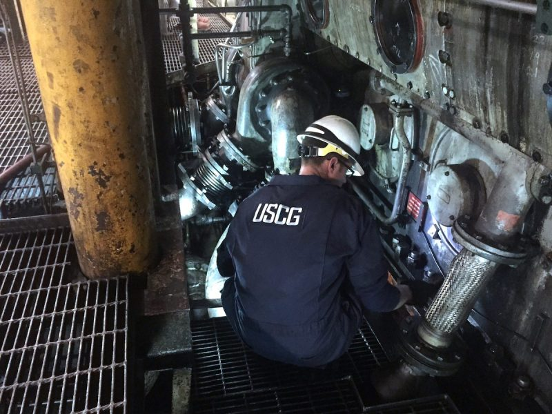 Lt. Gordon Gertiser, a marine inspector with U.S. Coast Guard Sector Sault Ste. Marie, inspects the engine room for possible damage aboard the motor vessel Roger Blough, May 30, 2016, in Lake Superior. U.S. Coast Guard Photo