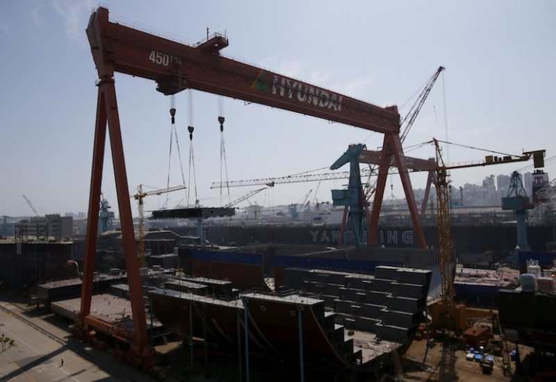 A part of the structure of a ship (bottom C) is lifted by giant crane at Hyundai Heavy Industries' Shipyard in Ulsan, South Korea, May 13, 2015. REUTERS/Kim Hong-Ji/File Photo