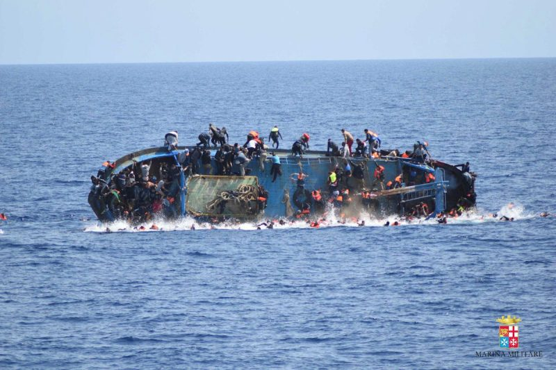 "Migrants are seen on a capsizing boat before a rescue operation by Italian navy ships ""Bettica"" and ""Bergamini"" (unseen) off the coast of Libya in this handout picture released by the Italian Marina Militare on May 25, 2016. Marina Militare/Handout via REUTERS Marina Militare/Handout via REUTERS"